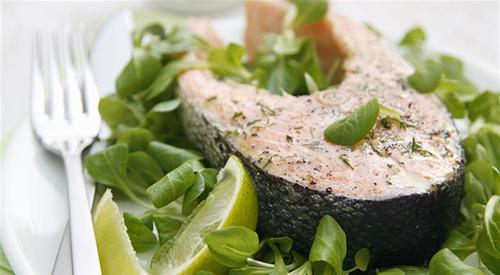 Salmon cutlet with orange vinaigrette and watercress