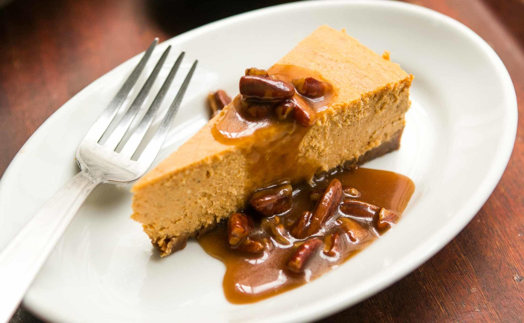 Pumpkin Cheesecake with Pecan Praline Sauce