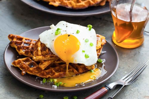 Sweet potato waffles with fried egg bacon and scallions recipe simplyrecipes.com