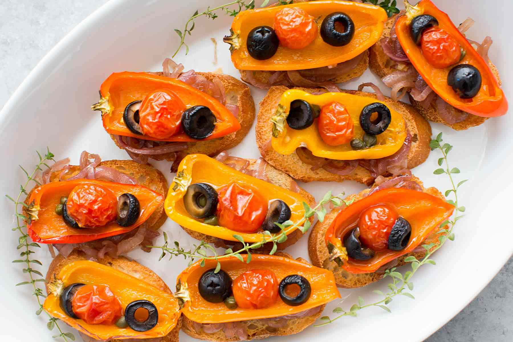 Roasted Pepper Crostini with Olives, Capers & Caramelized Onions Recipe | SimplyRecipes.com