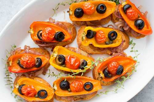 Roasted pepper crostini with olives capers caramelized onions recipe simplyrecipes.com