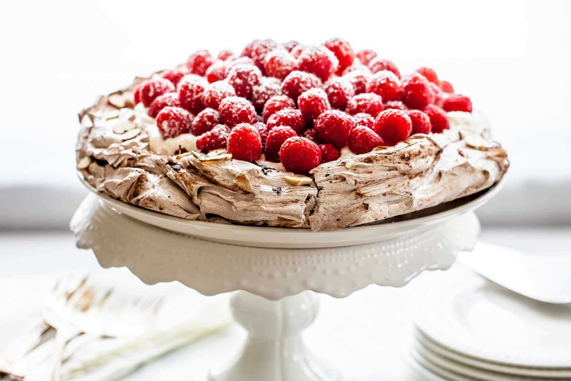 Chocolate Pavlova with Whipped Cream and Raspberries Recipe | SimplyRecipes.com