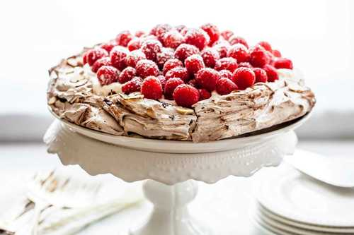 Chocolate pavlova with whipped cream and raspberries recipe simplyrecipes.com