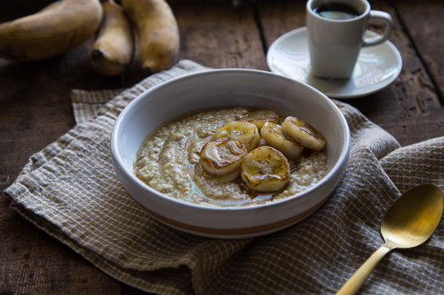 Coconut curry oatmeal with fried thai bananas and honey fake food free