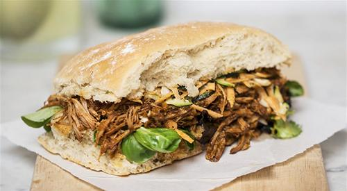 Pulled pork sandwich with basil