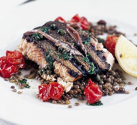 Grilled wild salmon with anchovies, capers & lentils | BBC Good Food