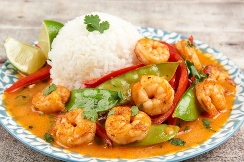 Thai red curry shrimp with jasmine rice and snow peas