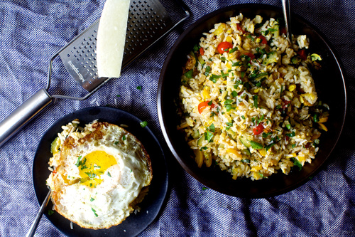 Fried rice with zucchini tomatoes and parmesan