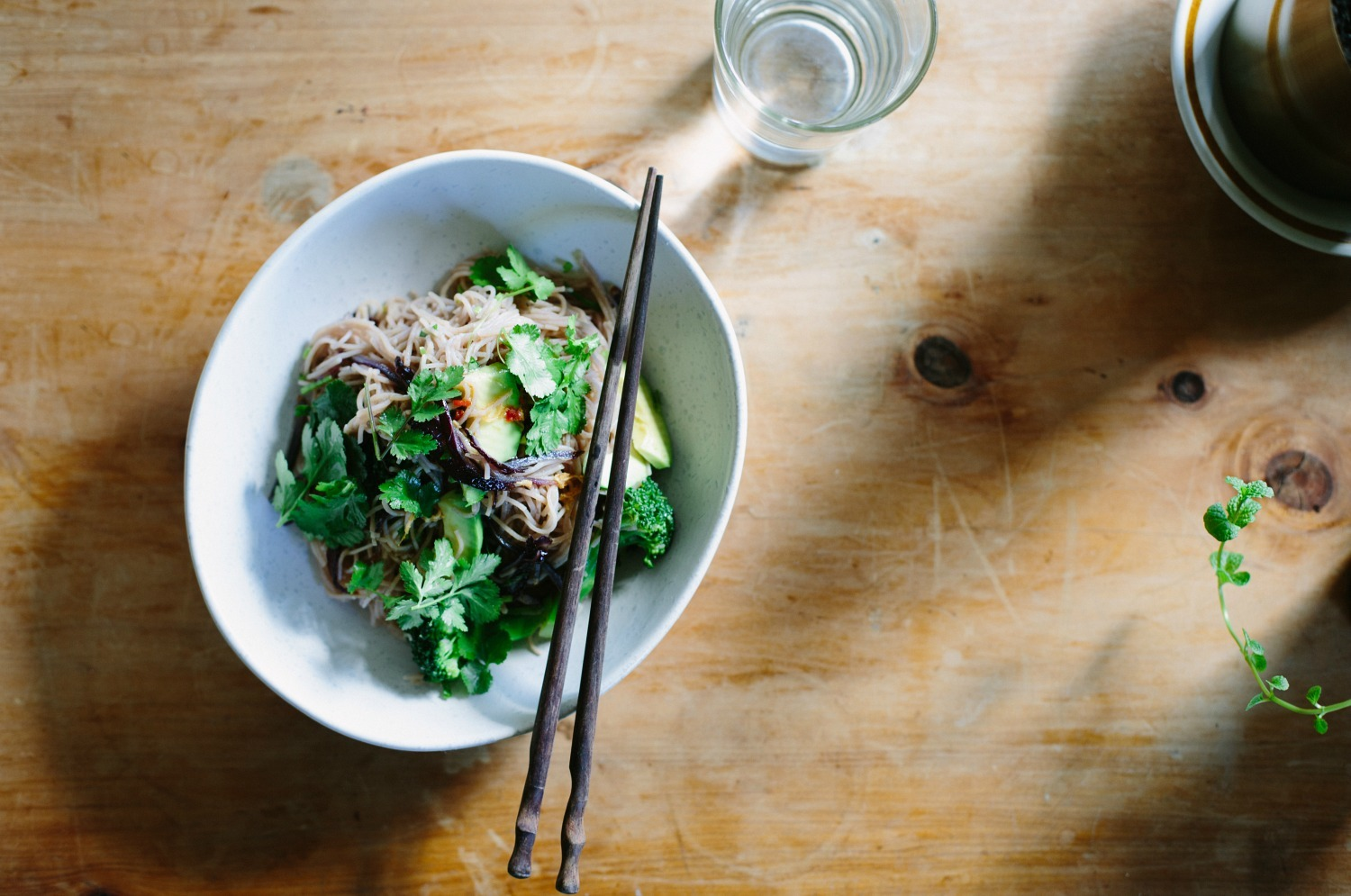 Red rice noodle salad with avocado, broccoli + soy ginger dressing
