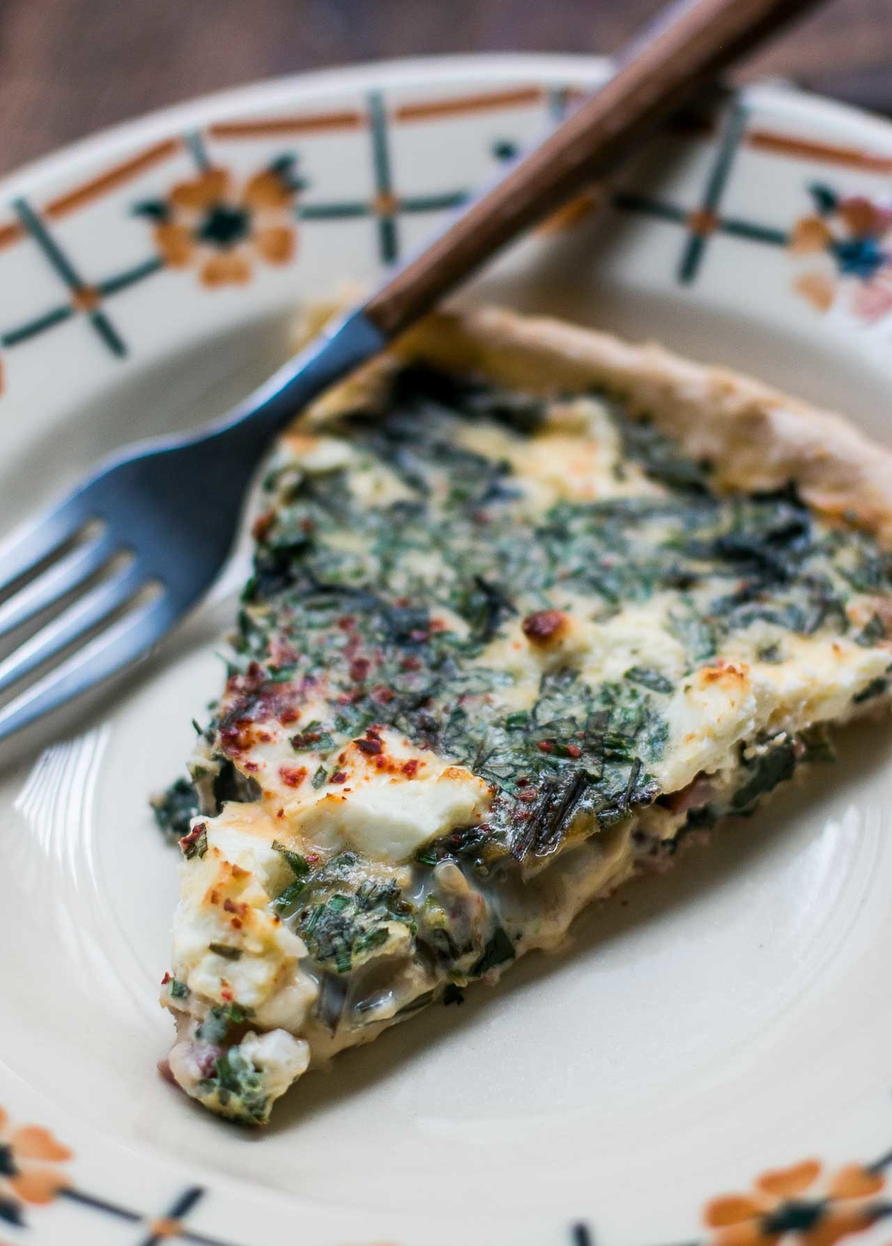 French quiche with greens, bacon and feta