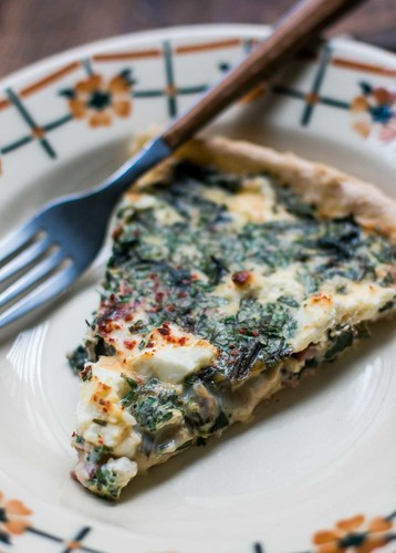 French quiche with greens bacon and feta
