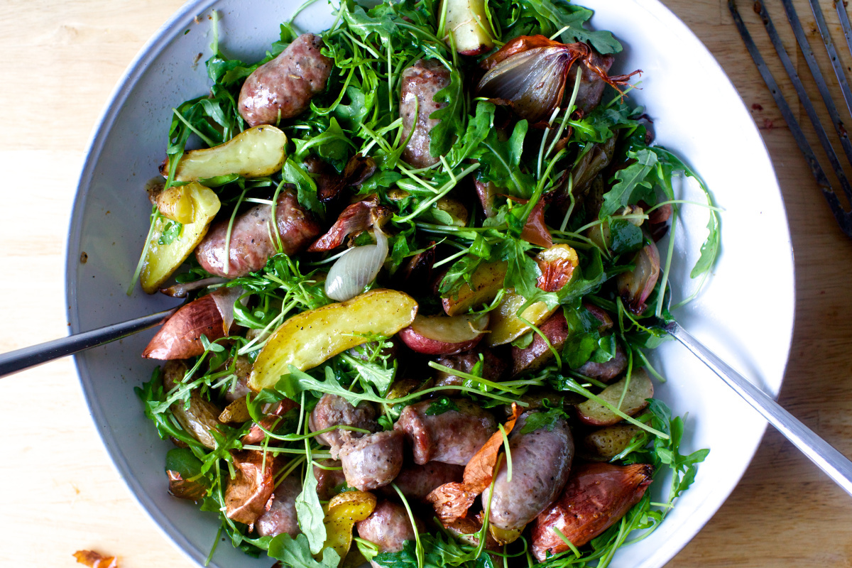 sausage and potato roast with arugula